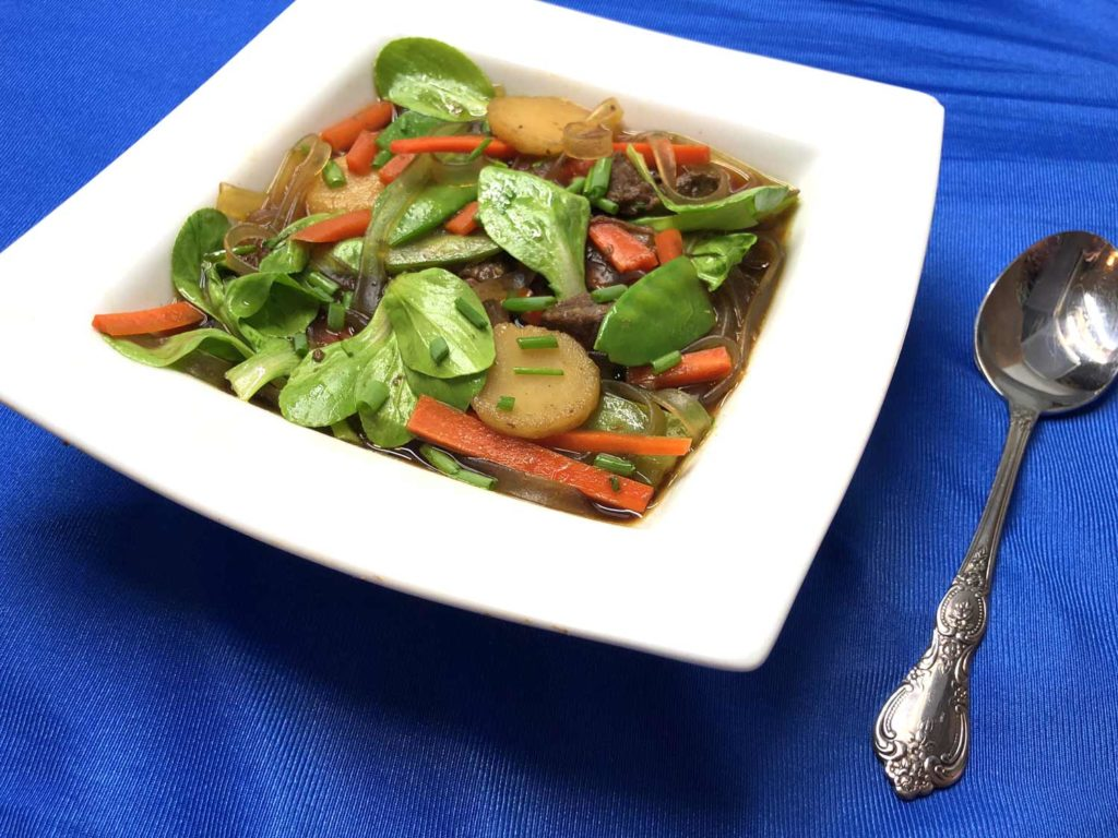 Asian-style soup in white bowl