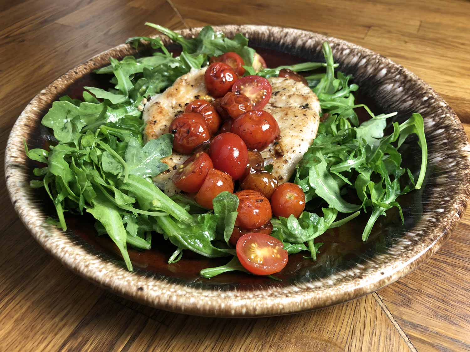 arugula, chicken breast, and tomatoes
